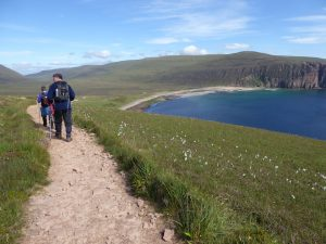 Hiking on coastal trail in Scotland